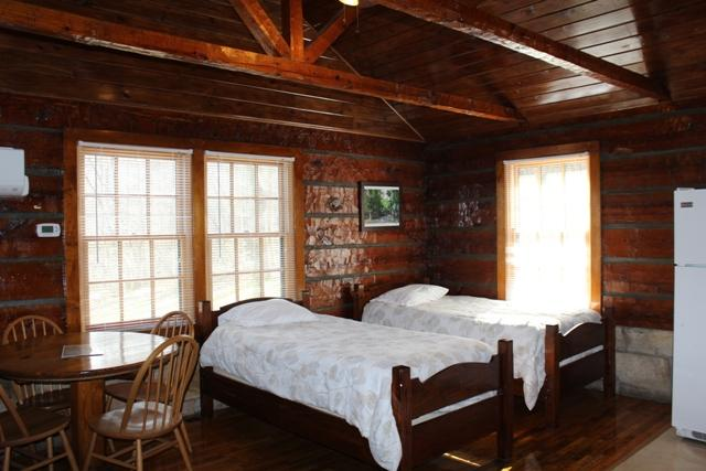 Rustic Cabin Living Area with Twin Beds