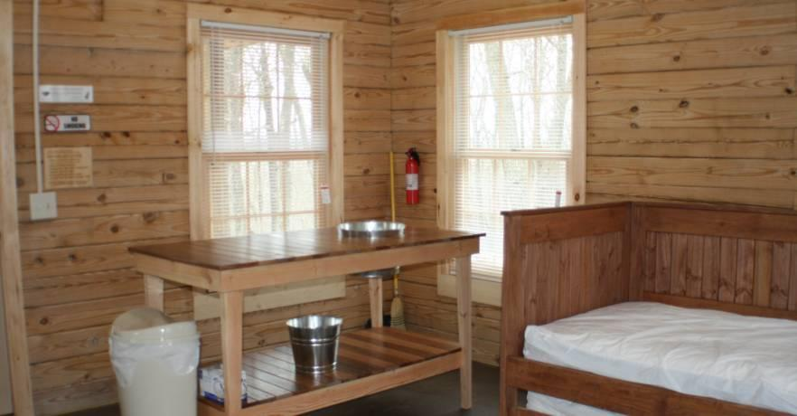 Camping Cabin Inside sink and trundle bed