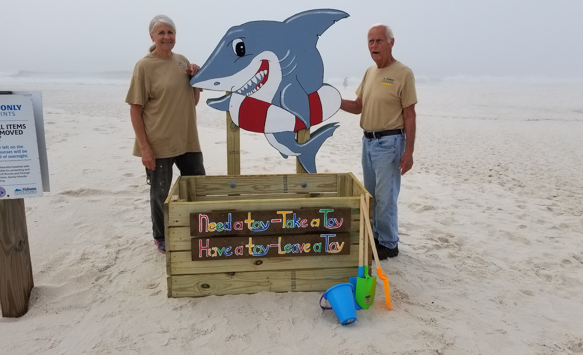 Volunteer Camp Hosts Finished Project of Beach Toy Bins